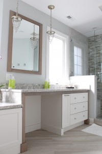 Beachy master bathroom with shower, tub, and makeup table