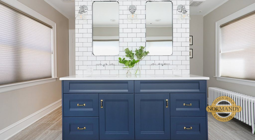 Navy blue cabinets in master bathroom