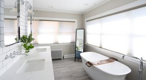 Master Bathroom with freestanding tub in front of large windows