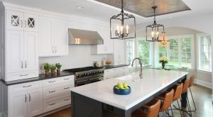 Transitional style kitchen with white painted cabinets