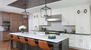 White and gray painted cabinets with stained kitchen cabinets