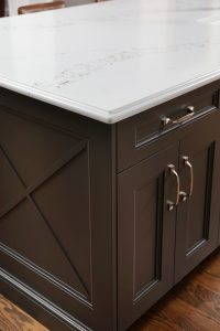 X design at the end of island cabinetry