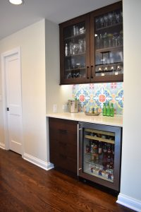 wet bar with colorful, patterned tile