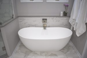freestanding tub with porcelain tile