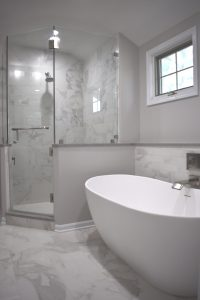 shower and freestanding tub in transitional bathroom