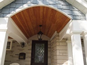 Covered front porch with barrel vault.