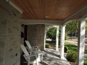 Covered front porch with pine bead board ceiling.