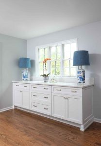 White cabinetry blue lamps