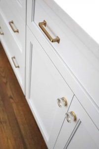 white cabinetry gold knobs