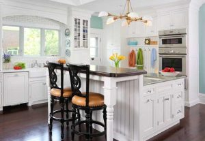 White kitchen with dual level countertop
