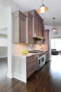 Galley kitchen with stained cabinets