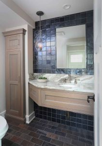 Gray stained powder room cabinets with extra storage