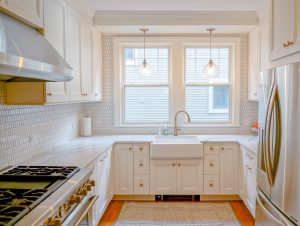 Updated kitchen with backsplash, cabinetry fixtures and hardware