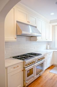 Side by Side double oven, stainless range hood