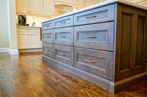 Dark wood center island with drawers for storage