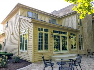 Addition with wall of windows and sliding glass doors