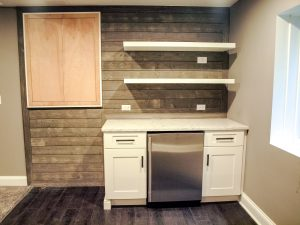 Built in white cabinets, open shelving and beverage refrigerator