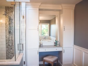 Seated vanity, makeup mirror, custom built tall cabinets