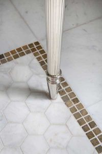 White hexagon tile with white grout